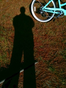 shadow of photographer and bicycle wheel